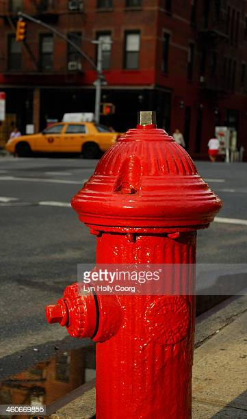 red fire hydrant and yellow taxi in new york city - lyn holly coorg stock pictures, royalty-free photos & images
