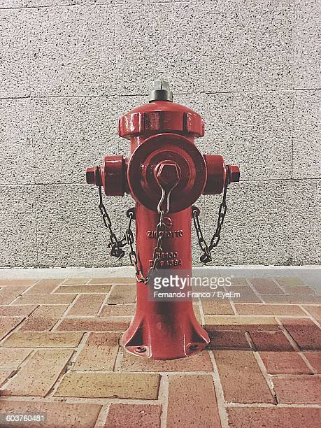 Red Fire Hydrant On Footpath
