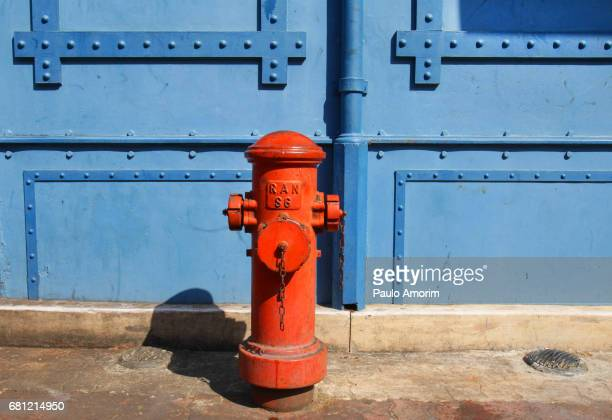 Red fire hydrant on the street