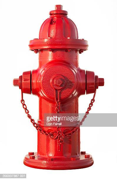 red fire hydrant on white background - fire hydrant stock pictures, royalty-free photos & images