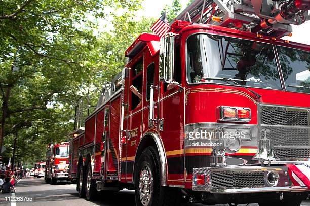 red fire trucks in parade - firetruck stock photos and pictures
