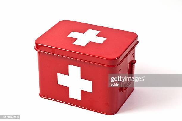 red first aid box on white background - first aid kit stock pictures, royalty-free photos & images