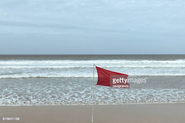Red flag against the sea