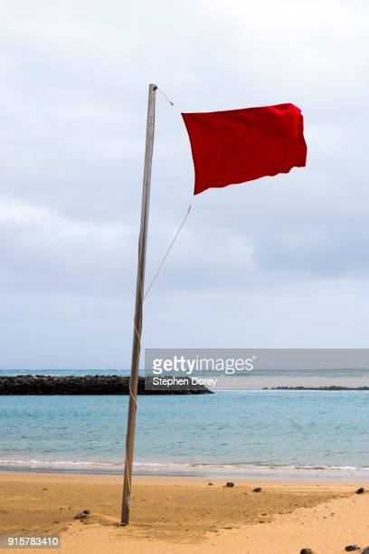 A red flag flying on the beach on the Canary Island of Fuerteventura