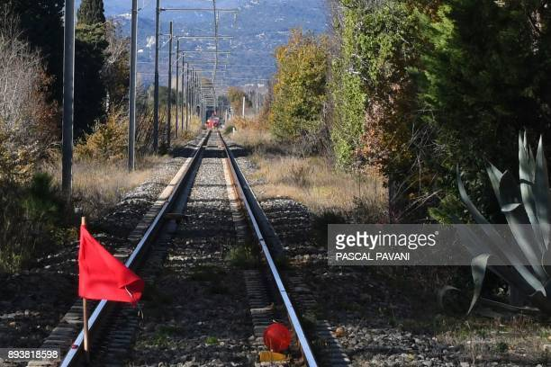 A red flag is displayed on the railway between Millas and Saintfeliud'Avallas on December 16 2017 as French gendarmes and employees of the National...