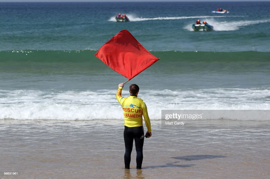 A red flag is waved from the beach as Zapcat power boats practice in the surf at Fistral Beach on April 23, 2010 in Newquay, England. Cornwall's Newquay is this weekend playing host to the Blue Chip Zapcat Grand Prix where small inflatable catamaran powerboats built for speed with 50hp engines, will battle it out in the national championship.