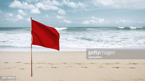 red flag on beach - flag stock pictures, royalty-free photos & images