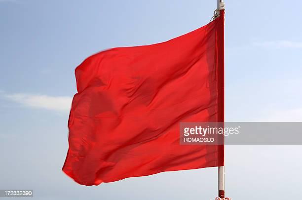 Red flag on the beach in Italy