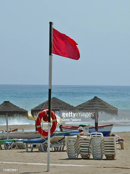 red flag up on beach - dorte fjalland stock pictures, royalty-free photos & images