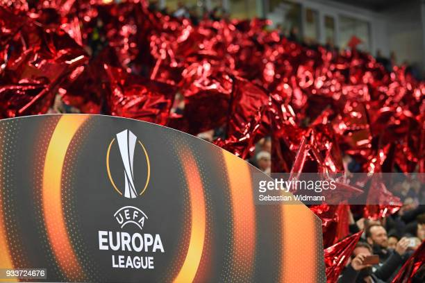 Red flags are seen behind the Europa League Logo prior to the UEFA Europa League Round of 16 2nd leg match between FC Red Bull Salzburg and Borussia...