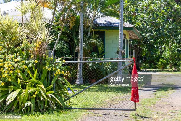 Red flags are seen hanging outside of homes of Apia residents indicating they have not been vaccinated for measles on December 5 2019 in Apia Samoa A...