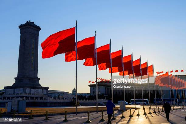Red flags flutter at Tiananmen Square on the last day of Spring Festival holiday on February 17, 2021 in Beijing, China.