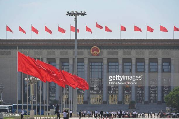 Red flags fly in front of the Great Hall of the People as the third session of the 13th National People's Congress holds closing meeting on May 28,...