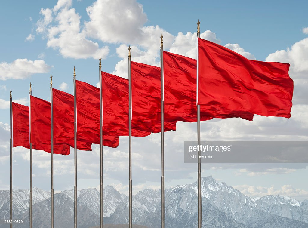 Red Flags, Mountains in Distance : Stock Photo