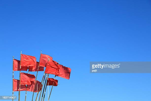 red flags on blue sky - pejft stock pictures, royalty-free photos & images