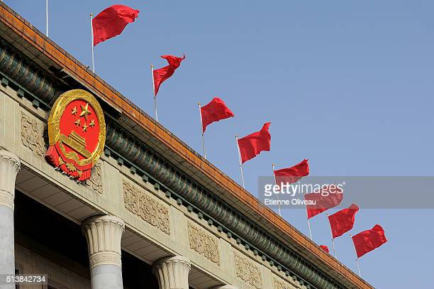 Red flags on top of the Great Hall of the People during the opening session of the China's National People's Congress on March 5 2016 in Beijing...