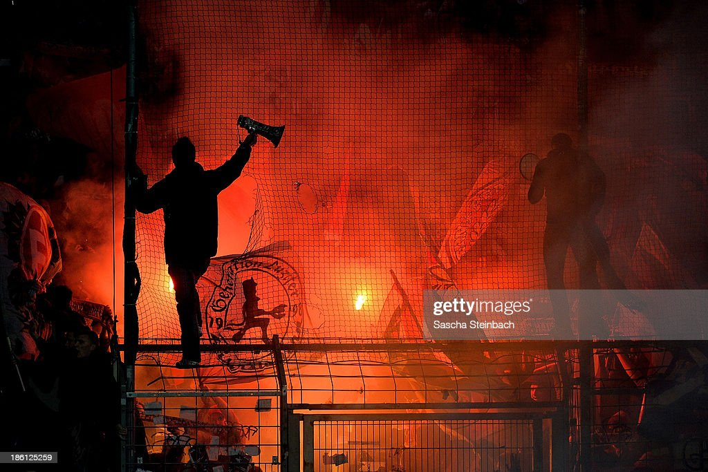 Red flares are seen in the club-wall of Kaiserslautern during the Second Bundesliga match between VfL Bochum and 1. FC Kaiserslautern at Rewirpower Stadion on October 28, 2013 in Bochum, Germany.