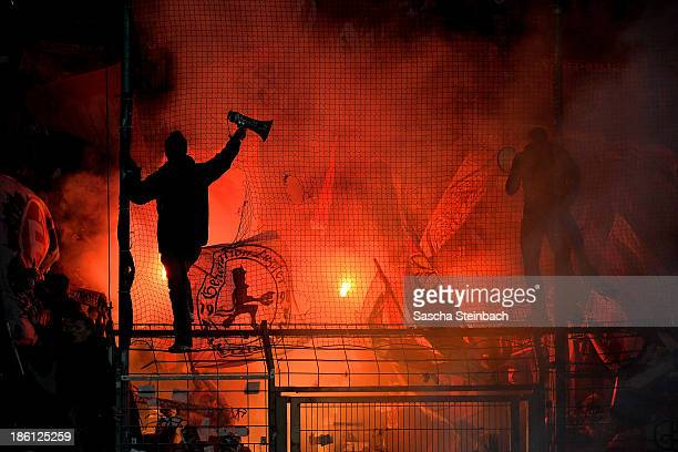Red flares are seen in the clubwall of Kaiserslautern during the Second Bundesliga match between VfL Bochum and 1 FC Kaiserslautern at Rewirpower...