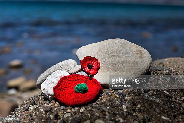 Red flowers and stones lay on the beach before the upcoming Dawn Service commemoration ceremony to honour Australian and New Zealand soldiers killed...