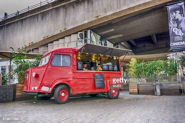 Red food van at roadside along the River Thames London