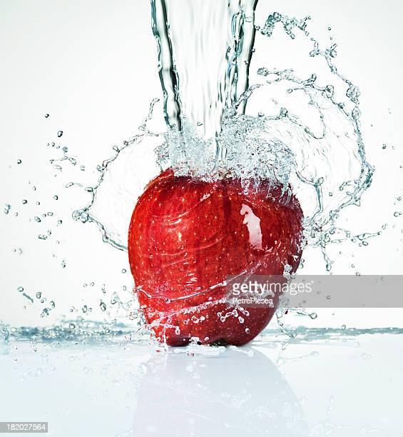 Red Fresh Apple. Water Splash. Health.
