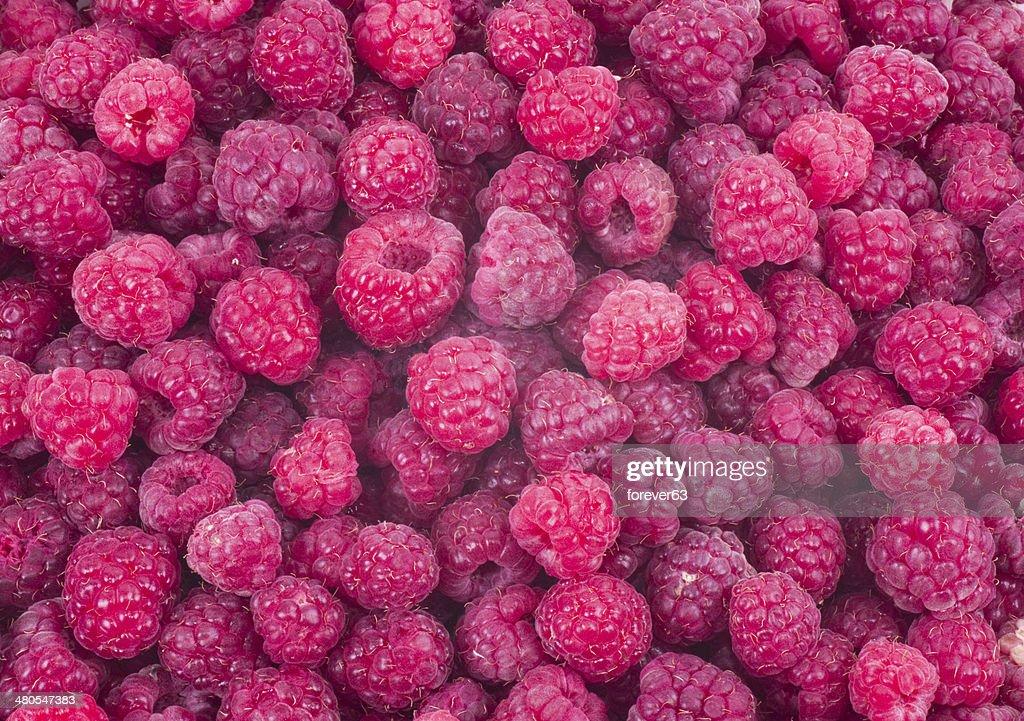 Red fresh raspberry background : Stock Photo