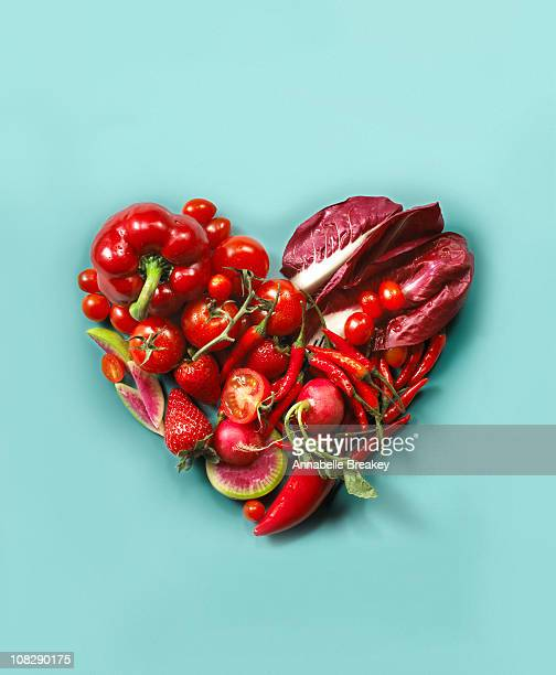 Red fruits and vegetables in the shape of a heart