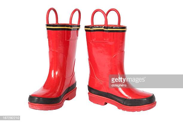 red galoshes - rubber boot stock pictures, royalty-free photos & images