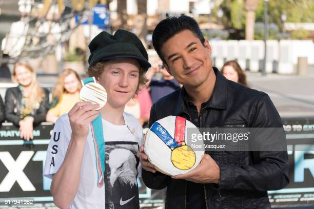 Red Gerard holds up his gold medal and Mario Lopez displays a donut with Olympic gold medal icing at 'Extra' at Universal Studios Hollywood on...
