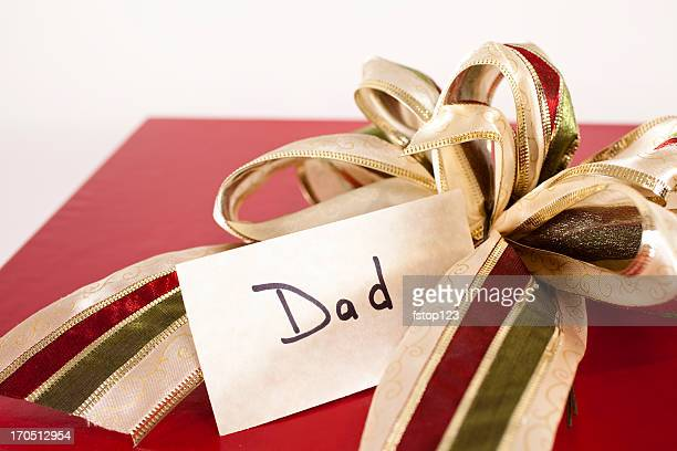 Red gift box, bow and tag for Dad. Chrismas present.
