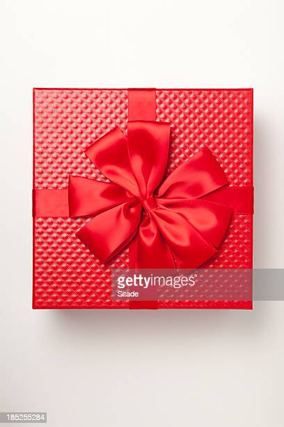 Red gift box tied with red ribbon and large bow