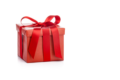 Red gift box with red ribbon isolated on white background 1045540342
