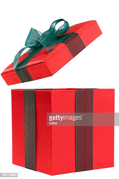 A red gift box with the lid open and a green bow
