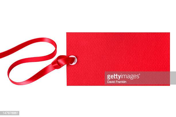 Red gift tag with red ribbon