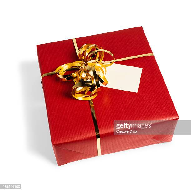 Red gift wrapped present with gift tag