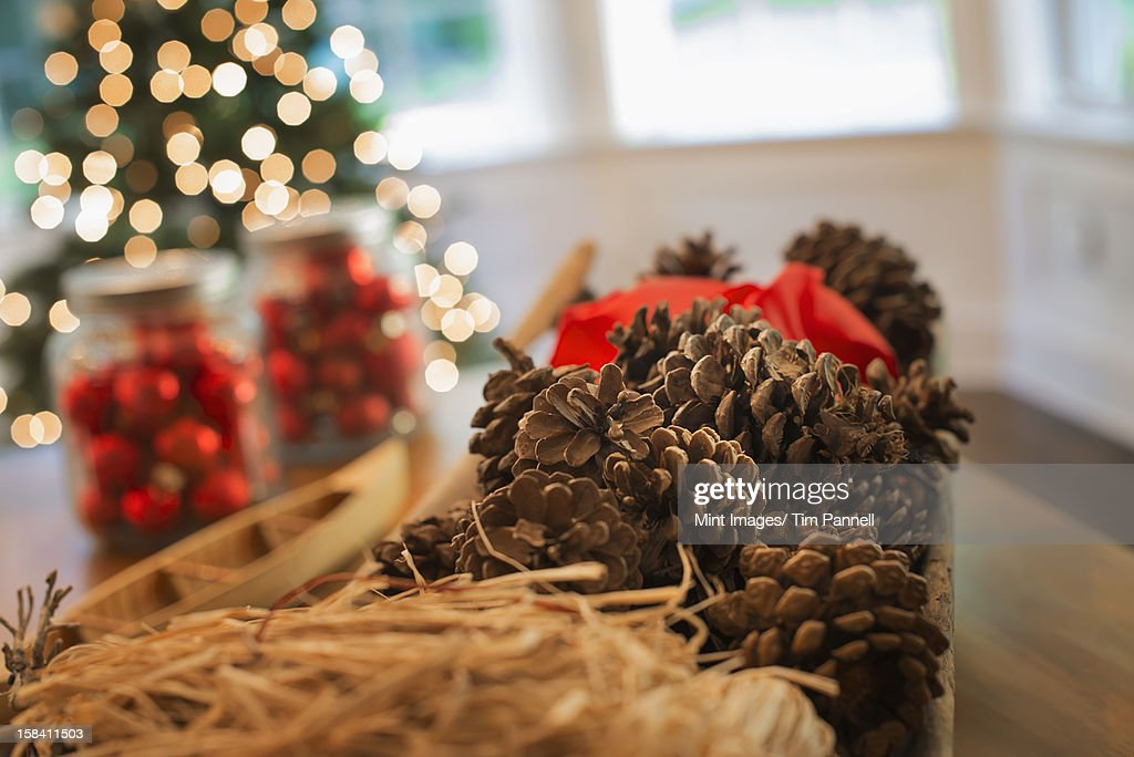 Red glass balls and pine cones. Christmas decorations and a Christmas tree. : Stock Photo