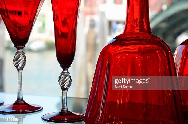red glasses on shelves in murano, venice - murano stock pictures, royalty-free photos & images