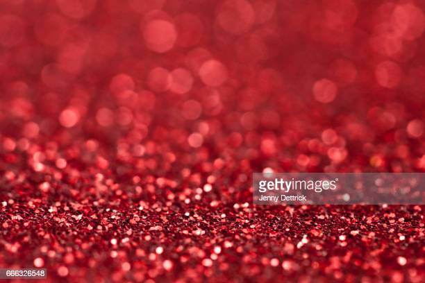 red glitter background - christmas background stock photos and pictures