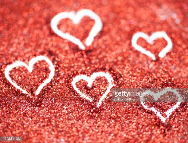 red glitter, heart shape - heart month stock photos and pictures