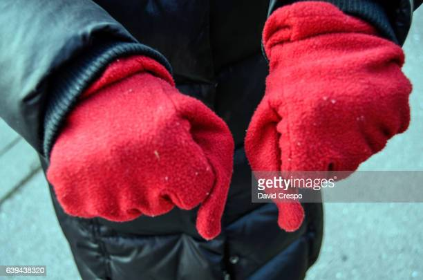 red gloves - mitten stock photos and pictures
