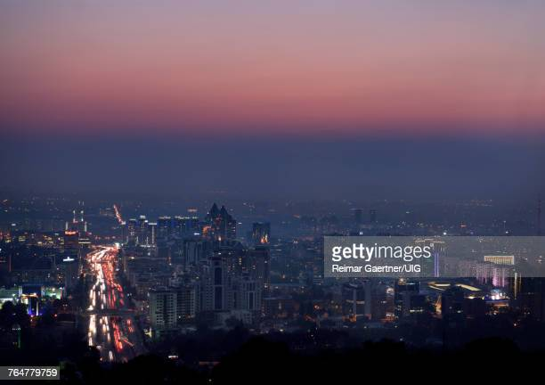 Red glow after sunset over Almaty with high rise towers and Al Farabi Avenue Kazakhstan