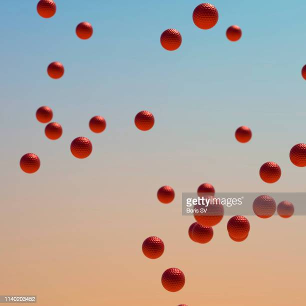red golf balls flying - golf background stock photos and pictures