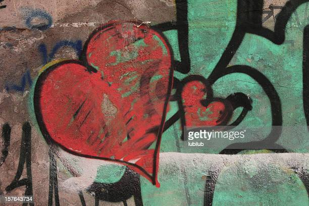 Red graffiti hearts on old wall - Love Concept