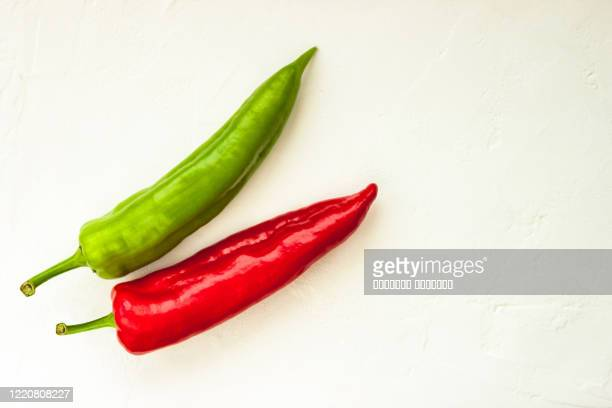 red, green cayenne hot chili pepper on white background immune support healthy eating concept - jalapeno pepper stock pictures, royalty-free photos & images
