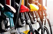 red green yellow orange color fuel gasoline dispenser  background