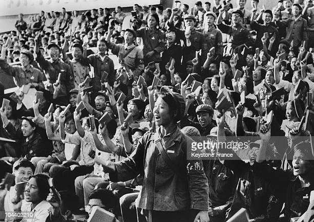 Red Guards waving the works of MAO whose thought they are defending against the revisionists during a student meeting In Beijing the viceminister for...