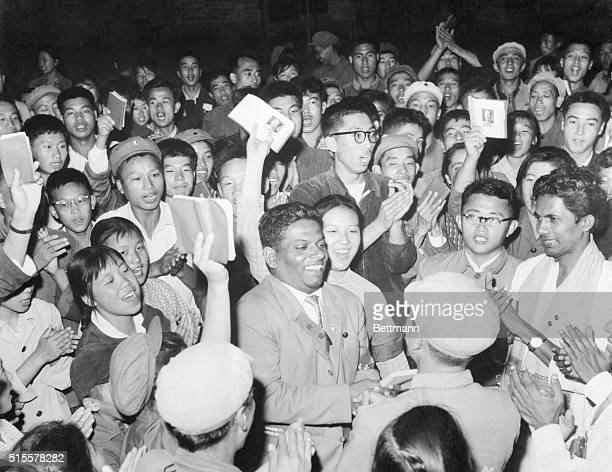Red Guards waving their copies of the Little Red Book greet members of a CeylonChina friendship delegation who have come to China to take part in...