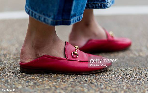 Red Gucci slipper outside Mulberry during London Fashion Week Spring/Summer collections 2017 on September 18 2016 in London United Kingdom