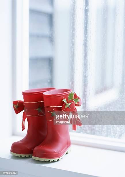 Red gum-boot on windowsill