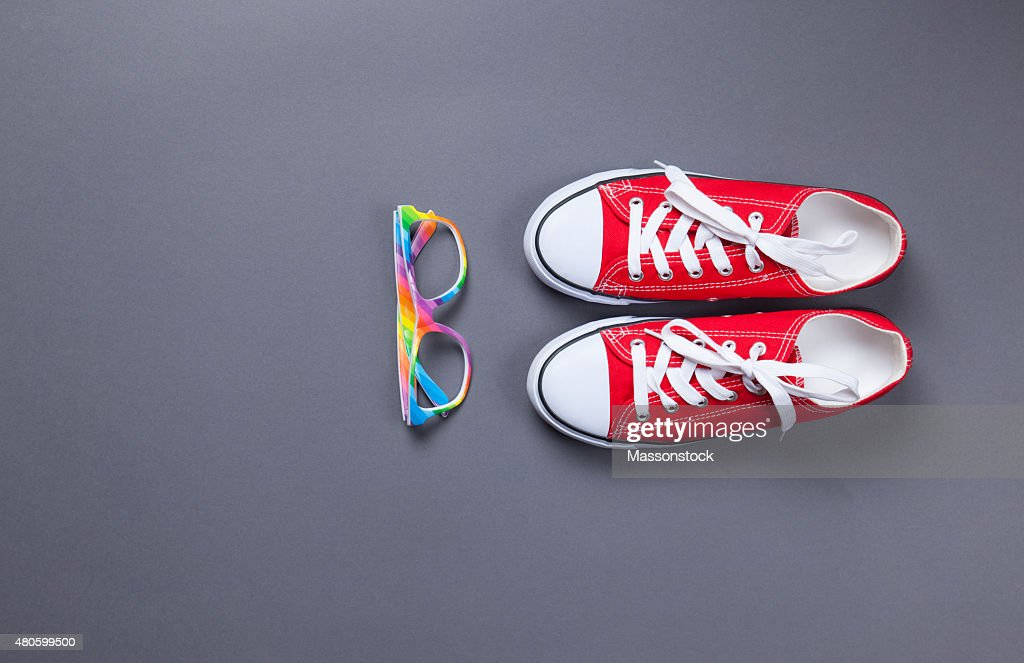 red gumshoes and glasses : Stock Photo